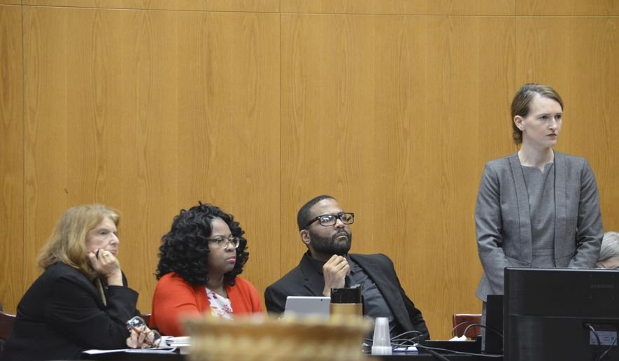 The defense team of Willie Cory Godbolt, second from right, listens to Circuit Judge David Strong Thursday, Feb. 20, 2020, during Day 6 of Godbolt's capital murder trial at the Pike County Courthouse in Magnolia, Miss. Pictured from left are defense attorney Alison Steiner, mitigation specialist Lela Hubbard, Godbolt and defense attorney Katherine Poor. Godbolt, 37, is on trial, for the May 2017 shooting deaths of eight people in Brookhaven. (Donna Campbell/The Daily Leader via AP,Pool)
