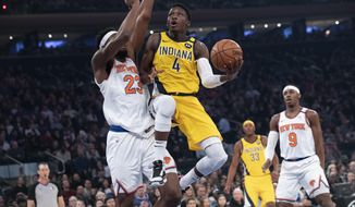 Indiana Pacers guard Victor Oladipo (4) goes to the basket against New York Knicks center Mitchell Robinson (23) in the first half of an NBA basketball game, Friday, Feb. 21, 2020, at Madison Square Garden in New York. (AP Photo/Mary Altaffer)