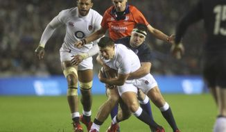 England's Ben Youngs, front, is tackled by Scotland's Stuart McInally during the Six Nations rugby union international match between Scotland and England at Murrayfield Stadium, in Edinburgh, Scotland, Saturday, Feb. 8, 2020. (AP Photo/Scott Heppell)