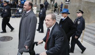 Harvey Weinstein leaves a Manhattan courthouse during his rape trial, Thursday, Feb. 20, 2020, in New York. (AP Photo/John Minchillo)