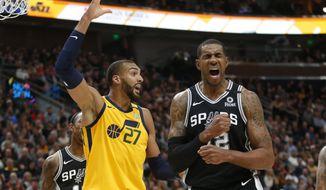 Utah Jazz center Rudy Gobert (27) reacts after fouling San Antonio Spurs forward LaMarcus Aldridge, right, during the first half of an NBA basketball game Friday, Feb. 21, 2020, in Salt Lake City. (AP Photo/Rick Bowmer)
