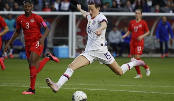 U.S. forward Megan Rapinoe scores against Canada during the second half of a CONCACAF women's Olympic qualifying soccer match Sunday, Feb. 9, 2020, in Carson, Calif. The U.S. won 3-0. (AP Photo/Chris Carlson)
