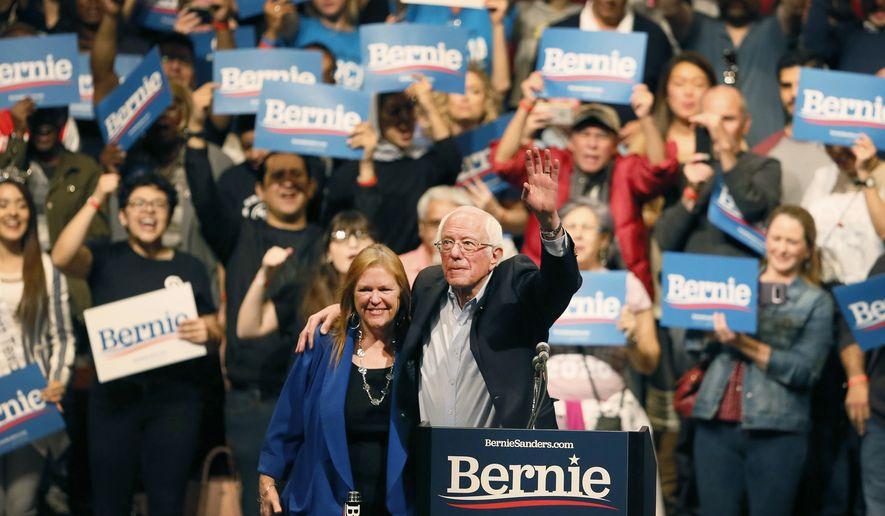 Democratic presidential candidate Sen. Bernie Sanders, I-Vt., with his wife Jane O'Meara Sanders, waves his hand during a rally in El Paso, Texas, Saturday, Feb. 22, 2020. (Briana Sanchez/The El Paso Times via AP)