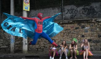 "A reveler dressed in Spider-Man costume strikes a pose at the ""Ceu na Terra"" or Heaven on Earth street party in Rio de Janeiro, Brazil, Saturday, Feb. 22, 2020. From very early in the morning revelers take the streets of the bohemian neighborhood Santa Teresa for one of the many block parties during the Carnival celebrations in the city. (AP Photo/Leo Correa)"