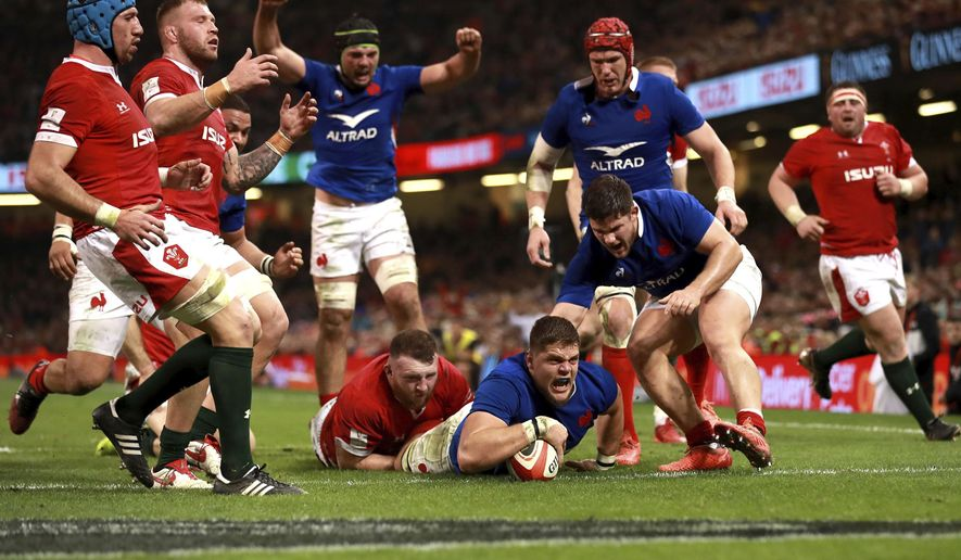 France's Paul Willemse, center, scores his side's second try of the game during the Six Nations match against Wales at the Principality Stadium, Cardiff, Wales, Saturday Feb. 22, 2020. (Adam Davy/PA via AP)