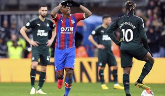 Crystal Palace's Patrick van Aanholt celebrates scoring his side's first goal of the game against Newcastle, during their English Premier League soccer match at Selhurst Park in London, Saturday Feb. 22, 2020. (Kirsty O'Connor/PA via AP)
