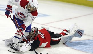 Montreal Canadiens centre Max Domi (13) scores on Ottawa Senators goaltender Craig Anderson (41) during first period NHL hockey action in Ottawa on Saturday, Feb. 22, 2020. (Fred Chartrand/The Canadian Press via AP)