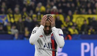 PSG's Neymar reacts during the Champions League round of 16 first leg soccer match between Borussia Dortmund and Paris Saint Germain in Dortmund, Germany, Tuesday, Feb. 18, 2020. (AP Photo/Martin Meissner)