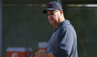 Cleveland Indians manager Terry Francona watches infield drills during spring training baseball workouts Friday, Feb. 21, 2020, in Goodyear, Ariz. (AP Photo/Ross D. Franklin)