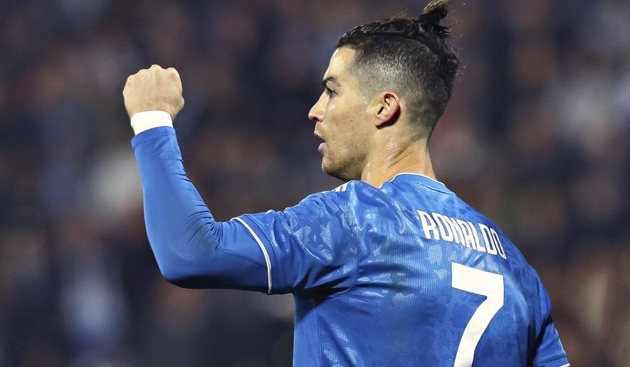 Juventus' Cristiano Ronaldo celebrates scoring his side's first goal, during an Italian Serie A soccer match between Spal and Juventus at the Paolo Mazza stadium in Ferrara, Italy, Saturday, Feb. 22, 2020. (Filippo Rubin/LaPresse via AP)