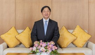 In this Feb. 12, 2020, photo released by Imperial Household Agency of Japan, Japan's Emperor Naruhito poses his residence in Tokyo ahead of his 60th birthday on Sunday, Feb. 23, 2020. Naruhito offered his sympathy to those affected by the new virus that emerged in China and said he hopes to see the outbreak contained soon. Birthday celebration plans had called for him to wave from the palace balcony to tens of thousands of well-wishers, but they were canceled as a precautionary anti-infection measure. (Imperial Household Agency of Japan via AP)