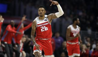 Sacramento Kings' Kent Bazemore (26) reacts after scoring against the Los Angeles Clippers during the first half of an NBA basketball game Saturday, Feb. 22, 2020, in Los Angeles. (AP Photo/Marcio Jose Sanchez)