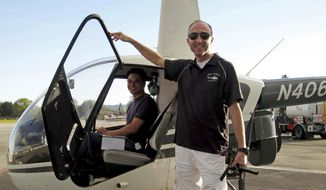 This undated file photo provided by Group 3 Aviation shows helicopter pilot Ara Zobayan standing outside a helicopter, at a location not provided. Zobayan violated federal flight rules in 2015 when he flew into busy airspace near Los Angeles International Airport despite being ordered not to by air traffic control, according to records from the Federal Aviation Administration obtained by the Los Angeles Times. (Group 3 Aviation via AP) ** FILE **