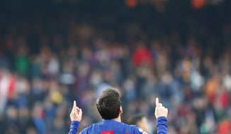 Barcelona's Lionel Messi celebrates after scoring his side's second goal during a Spanish La Liga soccer match between Barcelona and Eibar at the Camp Nou stadium in Barcelona, Spain, Saturday Feb. 22, 2020. (AP Photo/Joan Monfort)
