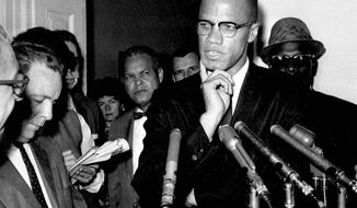 """FILE - In this May 16, 1963, file photo, civil rights leader Malcolm X speaks to reporters in Washington, D.C. """"Who Killed Malcolm X?"""" currently streaming on Netflix dives into questions surrounding his assassination and allegations of a botched investigation. (AP Photo/file)"""