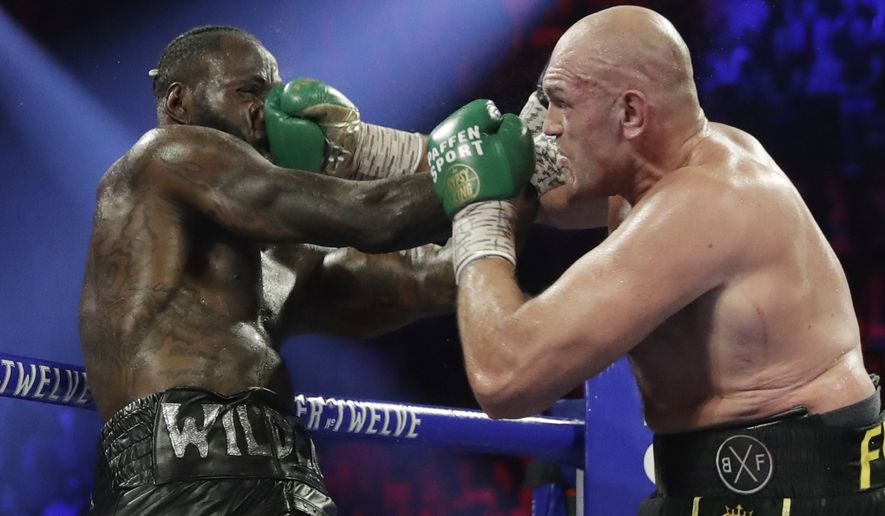 Tyson Fury, of England, lands a right to Deontay Wilder during a WBC heavyweight championship boxing match Saturday, Feb. 22, 2020, in Las Vegas. (AP Photo/Isaac Brekken)
