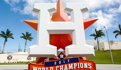"A sign outside the Houston Astros' spring training facility in West Palm Beach, Florida, bears the words ""2017 World Series Champions."" The Astros were punished after an investigation found they used a system of cameras and banging on trash cans to decode and relay opposing pitchers' signs to their batters at the plate. (Photo by All-Pro Reels / Ed Sheahin)"
