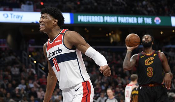 Washington Wizards forward Rui Hachimura (8), of Japan, reacts after he was fouled during the second half of an NBA basketball game as Cleveland Cavaliers center Andre Drummond (3) looks on, Friday, Feb. 21, 2020, in Washington. The Cavaliers won 113-108. (AP Photo/Nick Wass) ** FILE **
