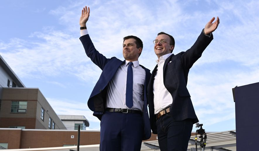 Democratic presidential candidate former South Bend, Ind., Mayor Pete Buttigieg, left, and his husband Chasten Buttigieg, right, wave to the crowd following a campaign event in Arlington, Va., Sunday, Feb. 23, 2020. (AP Photo/Susan Walsh)