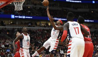 Washington Wizards' Bradley Beal (3) goes up for a shot during the first half of an NBA basketball game against the Chicago Bulls Sunday, Feb. 23, 2020, in Chicago. Chicago won 126-117. (AP Photo/Paul Beaty)