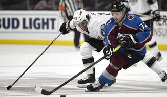 Colorado Avalanche right wing Joonas Donskoi, right, takes the puck as Los Angeles Kings left wing Alex Iafallo reaches for it during the second period of an NHL hockey game Saturday, Feb. 22, 2020, in Los Angeles. (AP Photo/Mark J. Terrill)