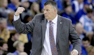 Creighton coach Greg McDermott gestures during the first half of an NCAA college basketball game against Butler in Omaha, Neb., Sunday, Feb. 23, 2020. (AP Photo/Nati Harnik)