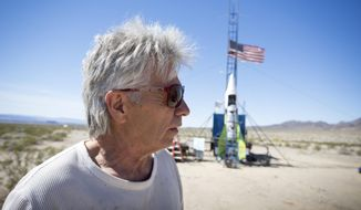 """FILE - In this March 6, 2018, file photo, """"Mad"""" Mike Hughes reacts after the decision to scrub another launch attempt of his rocket near Amboy, Calif. The self-styled daredevil died Saturday, Feb. 22, 2020, after a rocket in which he launched himself crashed into the ground, a colleague and a witness said.  (James Quigg/Daily Press via AP, File)"""
