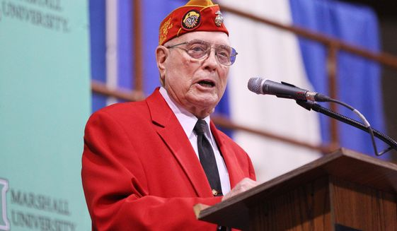 "FILE - In this Feb. 10, 2012 file photo, Medal of Honor recipient Hershel ""Woody"" Williams speaks during the Veterans Memorial Field House Finale in Huntington, W.Va.  The 75th anniversary of the start of the World War II Battle of Iwo Jima is Wednesday, Feb. 26, 2020. The battle is probably best remembered for the Feb. 23 flag raising atop Mount Suribachi, immortalized in a news photograph and a famous statue in Arlington, Va.(Mark Webb/The Herald-Dispatch via AP, File )"