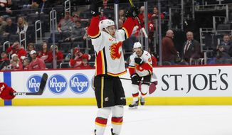 Calgary Flames left wing Andrew Mangiapane (88) celebrates his goal against the Detroit Red Wings in the second period of an NHL hockey game Sunday, Feb. 23, 2020, in Detroit. (AP Photo/Paul Sancya)