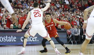 Maryland's Anthony Cowan, right, looks for an open lane as Ohio State's Kyle Young defends during the first half of an NCAA college basketball game Sunday, Feb. 23, 2020, in Columbus, Ohio. (AP Photo/Jay LaPrete)