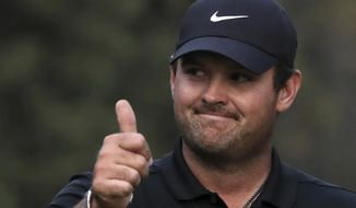 Patrick Reed of the United States gives the thumbs up after winning the WGC-Mexico Championship golf tournament, at the Chapultepec Golf Club in Mexico City, Sunday, Feb. 23, 2020. (AP Photo/Fernando Llano)