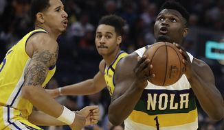 New Orleans Pelicans' Zion Williamson (1) looks to shoot against Golden State Warriors' Juan Toscano-Anderson, left, during the first half of an NBA basketball game Sunday, Feb. 23, 2020, in San Francisco. (AP Photo/Ben Margot)