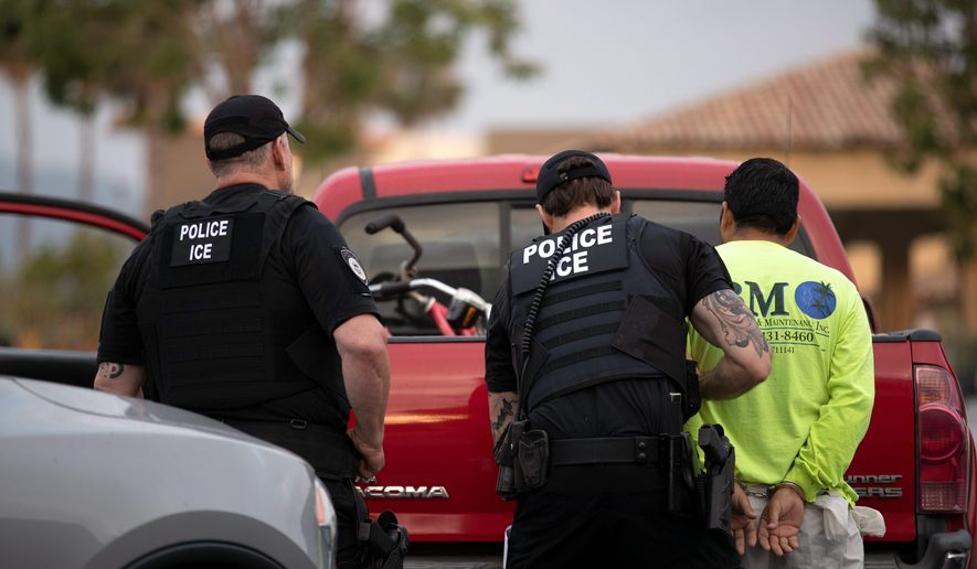 When the U.S. Immigration and Custom Enforcement teams have to go into communities to arrest people, it's more dangerous for the target migrants, the officers and the community, a recent report found. (Associated Press)