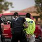 U.S. Immigration and Custom Enforcement officer makes an arrest. (Associated Press file photo)