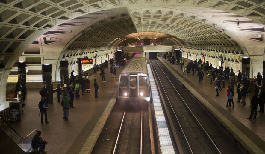 """The D.C. Metro system was built as a """"modern miracle"""" that """"remains the secret to our region's success,"""" said council member Charles Allen, who is proposing legislation to give city residents $100 a month on their SmarTrip cards. (Associated Press/File)"""