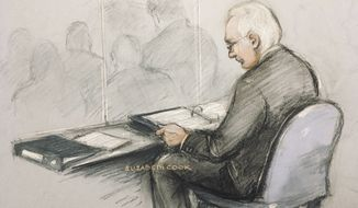 This is a court artist sketch of Wikileaks founder Julian Assange in the dock reading his papers as he appears at Belmarsh Magistrates' Court for his extradition hearing, in London, Monday, Feb. 24, 2020. (Elizabeth Cook/PA via AP)