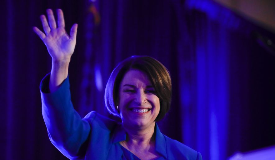 Democratic presidential candidate Sen. Amy Klobuchar, D-Minn walks onto the stage to speak at the First in the South Dinner, Monday, Feb. 24, 2020, in Charleston, S.C. (AP Photo/Matt Rourke)