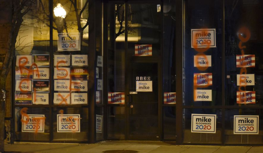 """The campaign headquarters of Democratic presidential candidate Mike Bloomberg is seen after it was spray-painted with the words """"racist,"""" """"sexist,"""" """"GOP"""" and """"oligarch""""  in Chicago on Monday, Feb. 24, 2020. Police are investigating the incident. (Carly Behm/Chicago Sun-Times via AP)"""