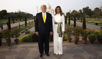 President Donald Trump, with first lady Melania Trump, pause as they tour the Taj Mahal, Monday, Feb. 24, 2020, in Agra, India. (AP Photo/Alex Brandon)