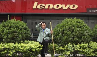A cleaner works near an empty store of Chinese computer manufacturer Lenovo at a district selling computer products in Beijing, China on Wednesday, May 15, 2019. China's factory output and consumer spending weakened in April as a tariff war with Washington intensified, adding to pressure on Beijing to shore up shaky economic growth.(AP Photo/Ng Han Guan)