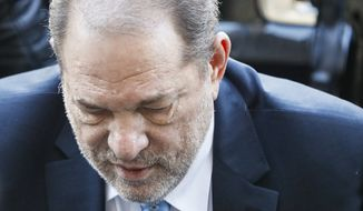 Harvey Weinstein arrives at a Manhattan courthouse for his rape trial, Monday, Feb. 24, 2020, in New York.  A jury convicted the Hollywood mogul of rape and sexual assault. The jury found him not guilty of the most serious charge, predatory sexual assault, which could have resulted in a life sentence.(AP Photo/John Minchillo)