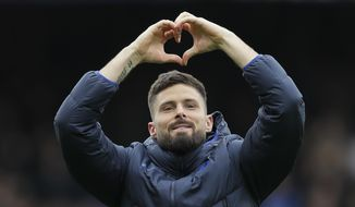 Chelsea's Olivier Giroud celebrates his team winning their English Premier League soccer match against Tottenham Hotspur in London, England, Saturday, Feb. 22, 2020. (AP Photo/Kirsty Wigglesworth)