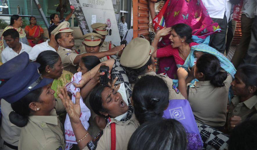 Indian police detain members of Centre of Indian Trade Unions protesting against the visit of U.S. President Donald Trump to India, in Hyderabad, India, Monday, Feb. 24, 2020. India poured on the pageantry with a joyful, colorful welcome for President Donald Trump who on Monday kicked off a whirlwind 36-hour visit that emphasizes pageantry over policy and a mega-rally to reaffirm U.S.-India ties while providing enviable overseas imagery for a president in a re-election year. (AP Photo/Mahesh Kumar A.)