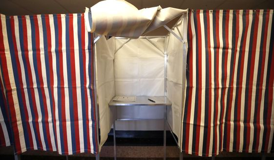 A booth is ready for a voter, Monday, Feb. 24, 2020, at City Hall in Cambridge, Mass. on the first morning of early voting in the state. (AP Photo/Elise Amendola)