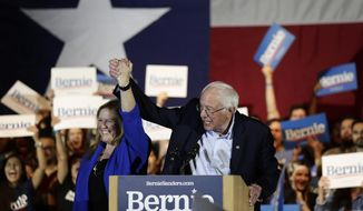 Democratic presidential candidate Sen. Bernie Sanders, I-Vt., with his wife Jane, left, speaks during a campaign event in San Antonio, Saturday, Feb. 22, 2020. (AP Photo/Eric Gay)