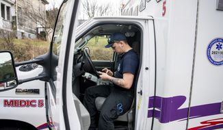 In this Jan. 11, 2020, photo first responder Brandon Smitley looks at a GPS map on his phone trying to find the correct address for a welfare check in Uniontown, Pa.. (Alexandra Wimley/Pittsburgh Post-Gazette via AP)