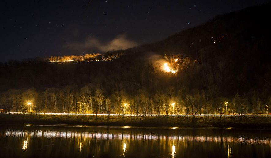 A fire burns on Mount Tammany in the Delaware Water Gap National Recreation Area in Hardwick Township, N.J., Sunday, Feb. 23, 2020. Firefighters from federal and New Jersey agencies were battling the forest fire that broke out in a popular hiking area near the Pennsylvania border. (Daniel Freel/The New Jersey Herald via AP)