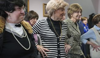 In this Jan. 22, 2020 photo, Dolly Rabinowitz, center, exercises with other Holocaust survivors at Nachas Health and Family Network in the Brooklyn borough New York. The community center provides survivors with meals, legal assistance, exercise classes and social events. (AP Photo/Emily Leshner)