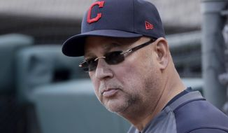 Cleveland Indians manager Terry Francona watches during the fourth inning of a spring training baseball game against the Kansas City Royals Sunday, Feb. 23, 2020, in Surprise, Ariz. (AP Photo/Charlie Riedel)