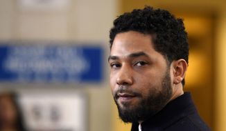 In this March 26, 2019, file photo, actor Jussie Smollett talks to the media before leaving Cook County Court in Chicago. Smollett is scheduled to make his first court appearance on Monday, Feb. 24, 2020, in Chicago since a special prosecutor announced that he'd been indicted for a second time on charges that he lied when he told police he was a victim of a racist and anti-gay attack. (AP Photo/Paul Beaty, File)